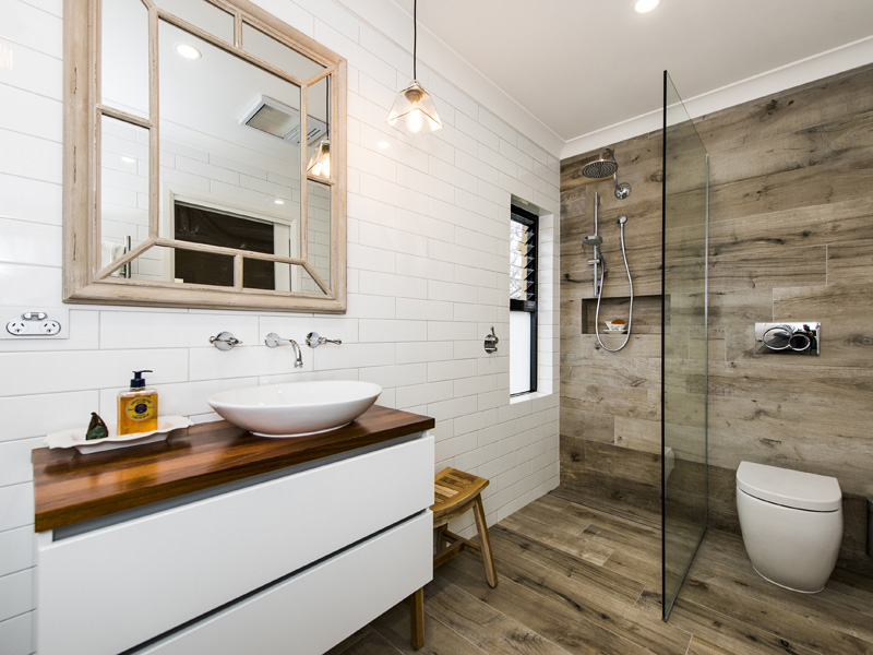 Bathroom wood like finish floors used also in the shower because of their waterproof nature.