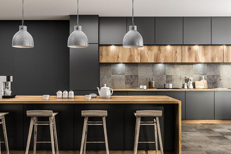dark kitchen cupboards with wood worktop