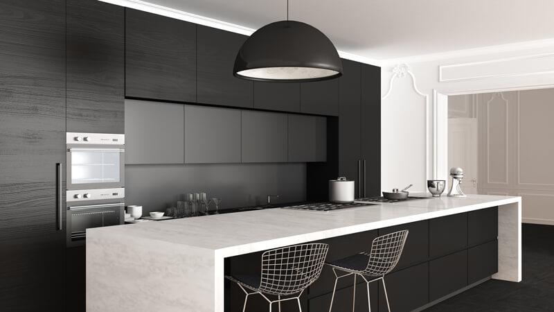 Matte black cupboards in a new kitchen