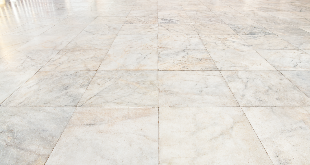 A natural stone floor suitable for a bathroom.