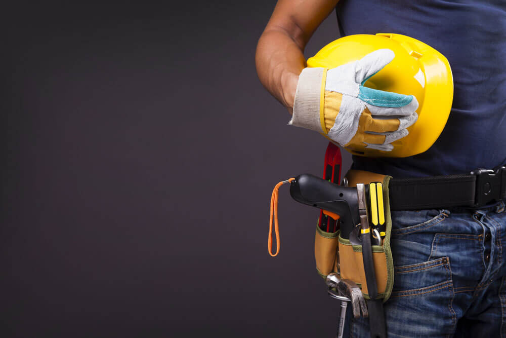 An image of a worker with a tool belt