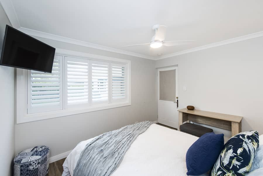 A fully renovated bedroom on display for Perth Renovations Co.