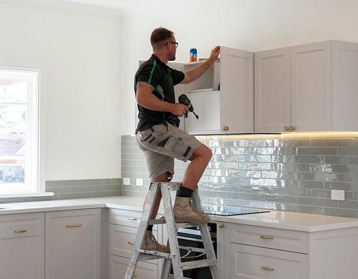 Working on ladder