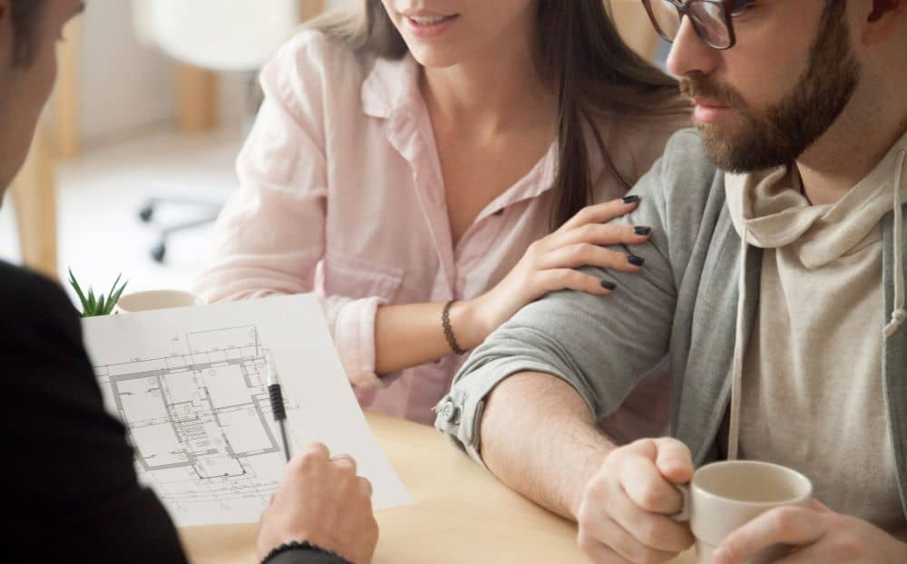 Couple consulting an architect for home renovation.