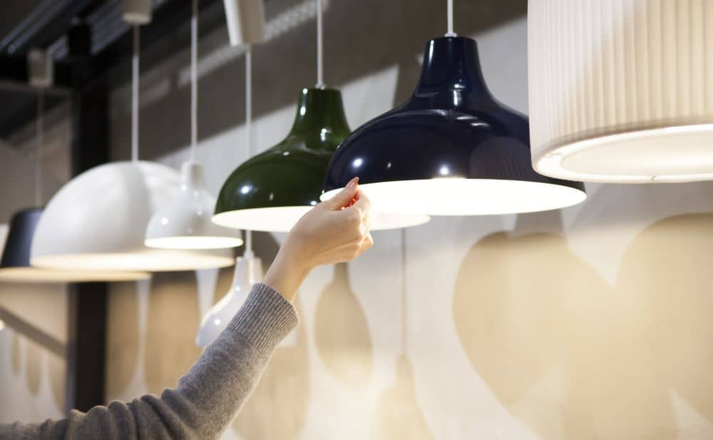 Woman's hands, selecting light fixture.
