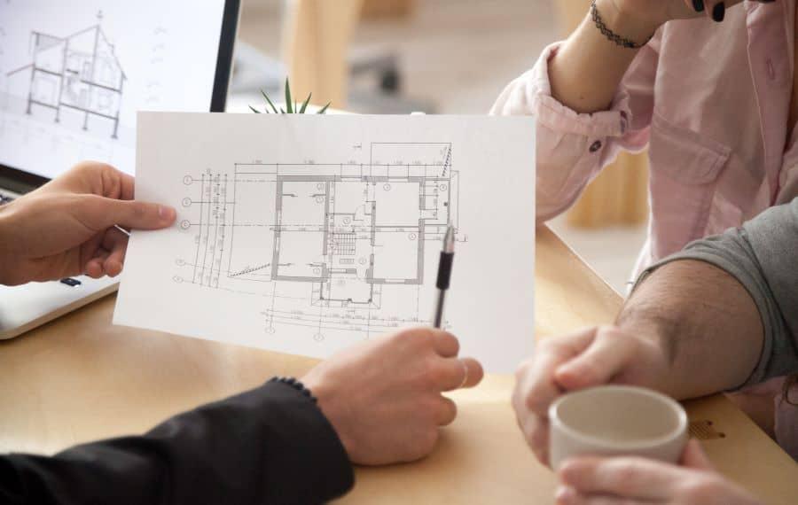 An architect explaining details to clients.