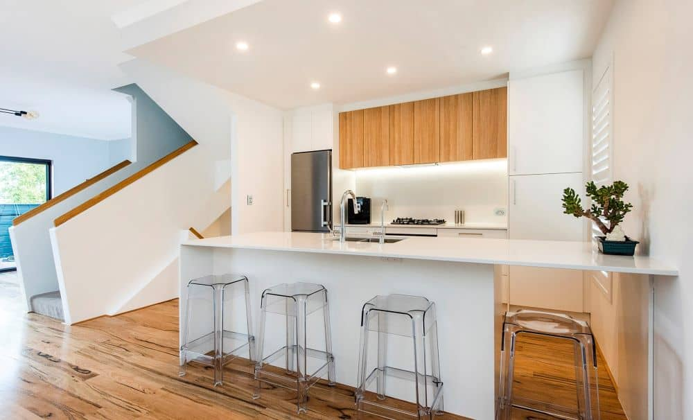 Kitchen islands are not out, but pros recommend that you opt to make it as minimal as possible.